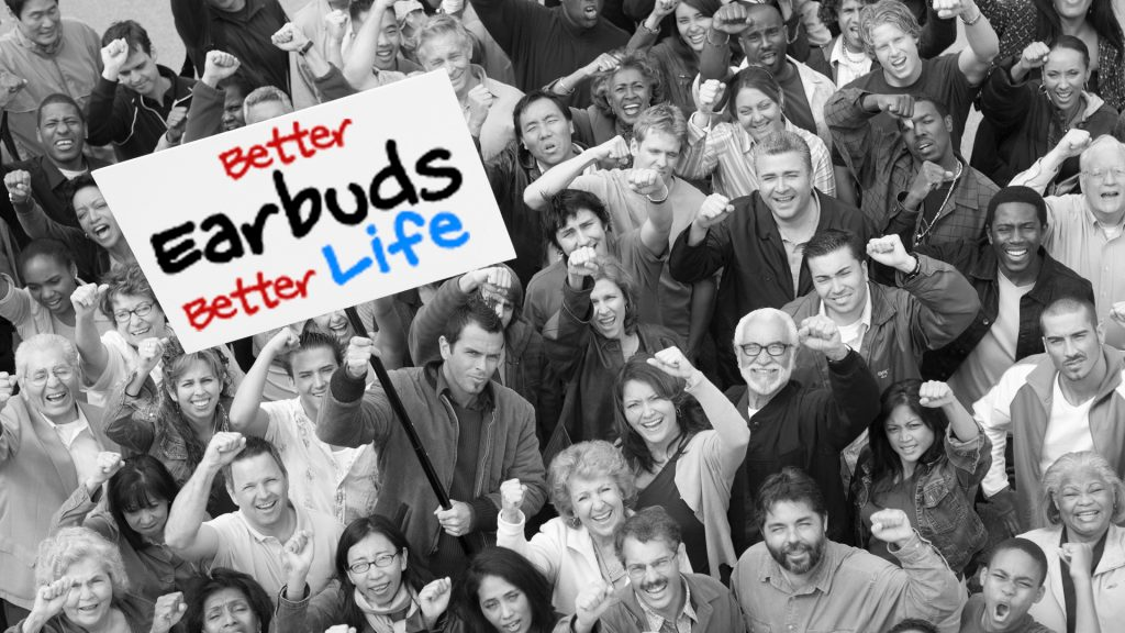 A crowd of mock protesters holding a Better Earbuds Better Life sign.