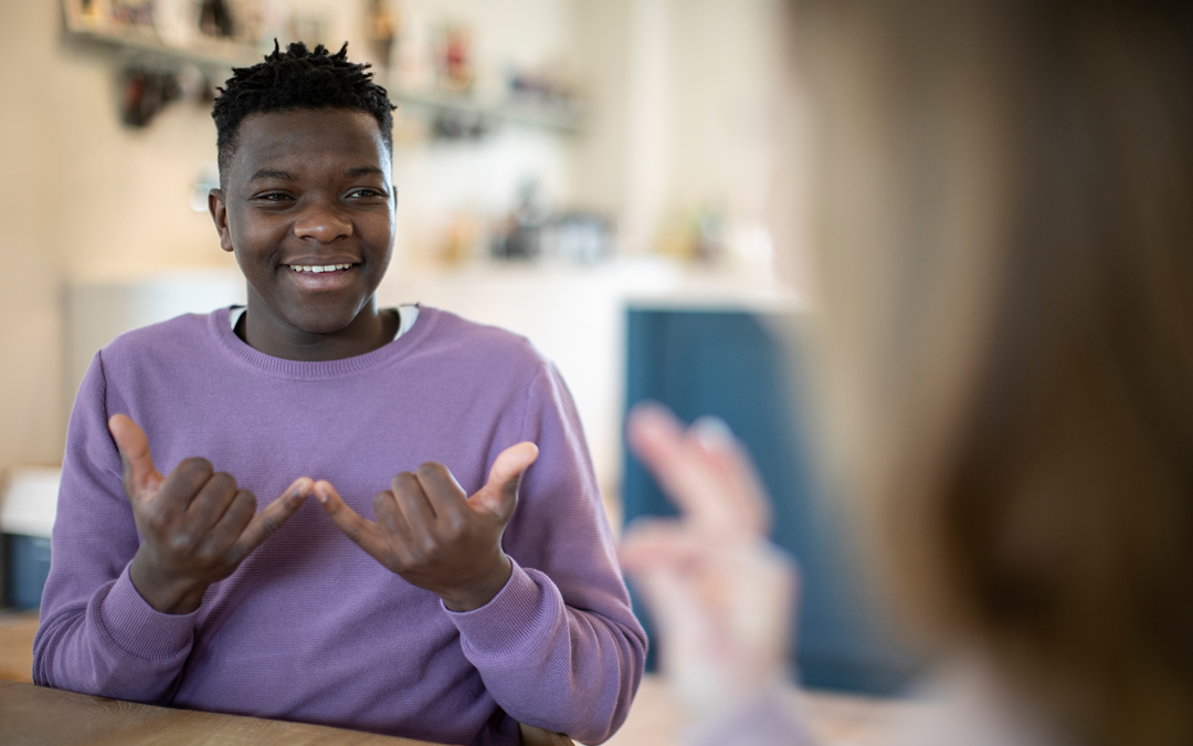 Teenage Boy and Girl Using ASL
